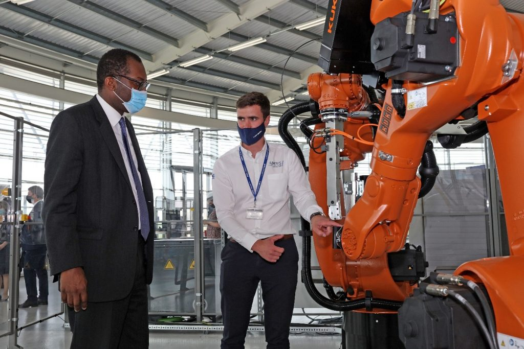 Dr Lloyd Tinkler shows Kwasi Kwarteng the robotic coil winding device. at a recent visit to the AMRC